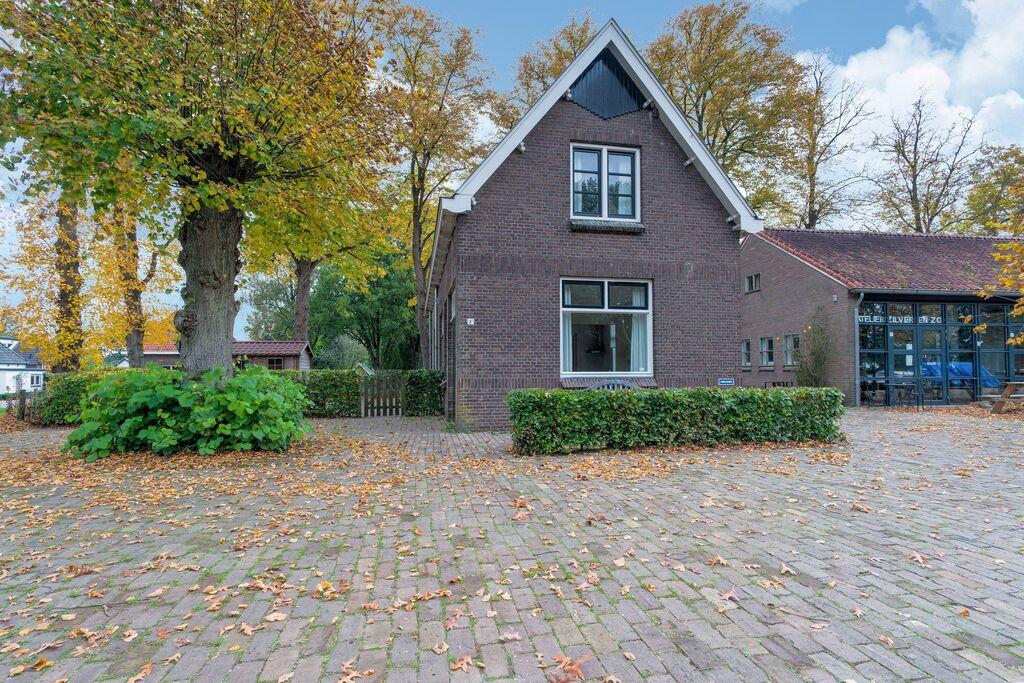 Voormalige arbeiderswoning in Dwingeloo aan het water - Boerderijvakanties.nl