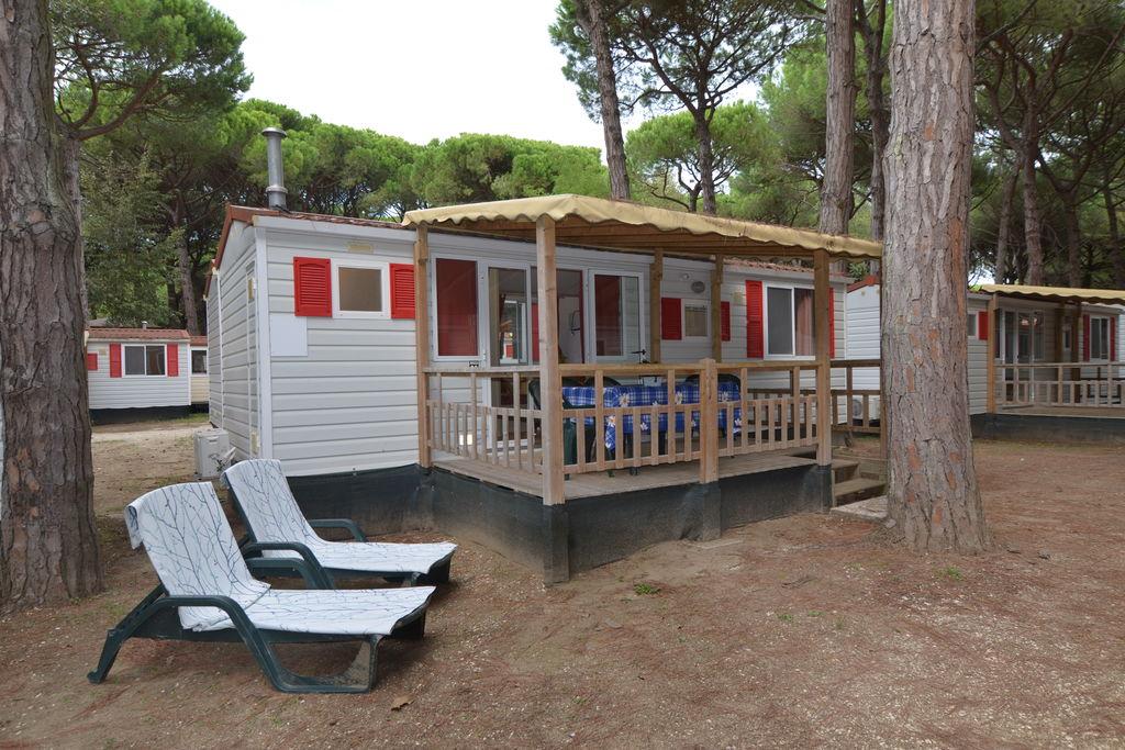Lido-di-Spina- Sta-caravan met zwembad  met wifi te huur