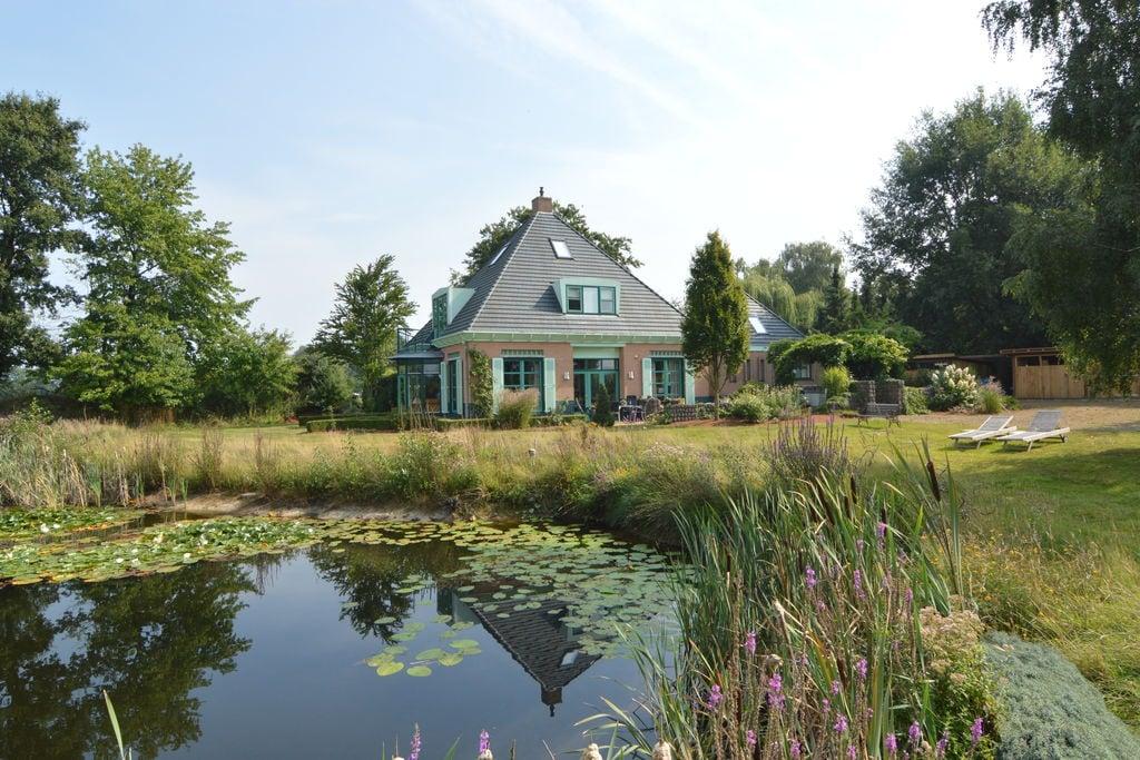 Luxe groepswoning met grote Finse sauna, overdekt terras en prachtige zwemvijver - Boerderijvakanties.nl