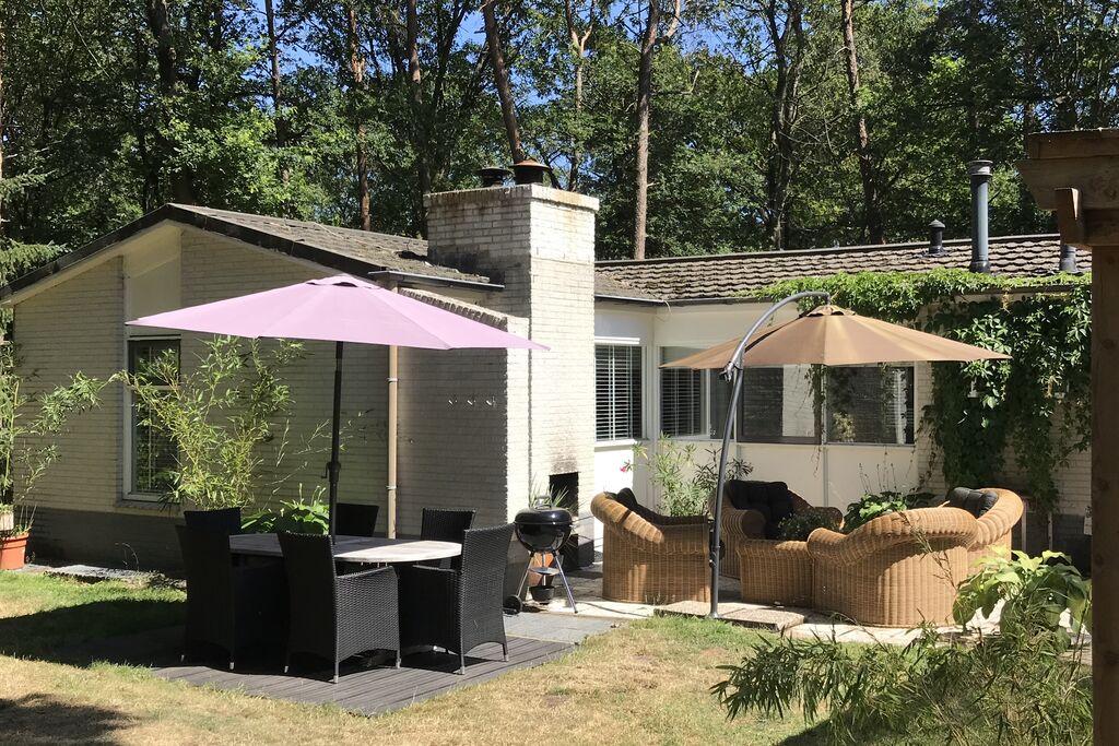 Vrijstaande villa met omheinde bostuin met speelgazon, jacuzzi en infraroodsauna - Boerderijvakanties.nl