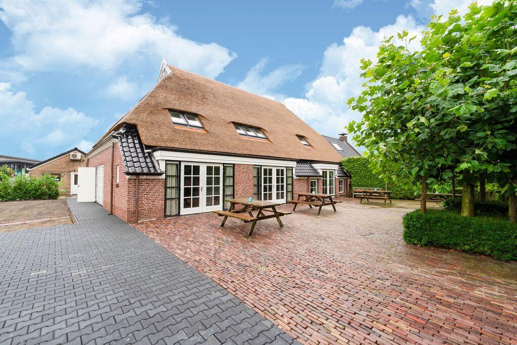 Sfeervolle boerderij in Friesland voor 20 personen met een hottub en sauna - Boerderijvakanties.nl
