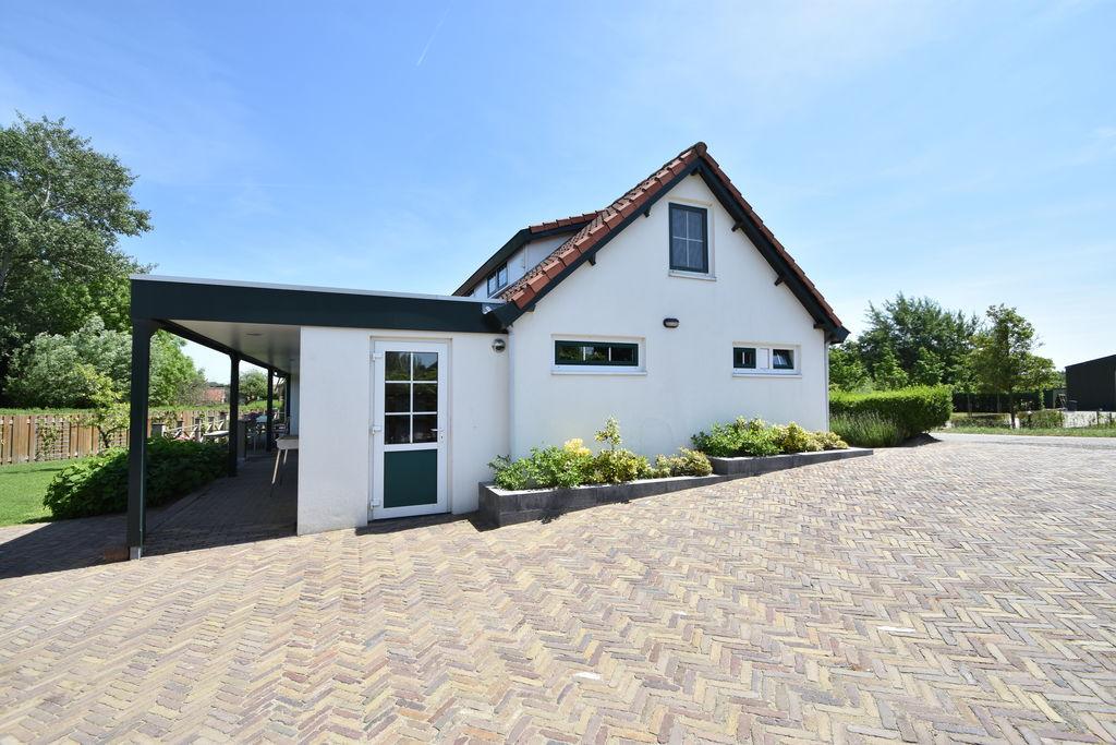 Luxueuze vakantiewoning in Oostvoorne met open haard - Boerderijvakanties.nl