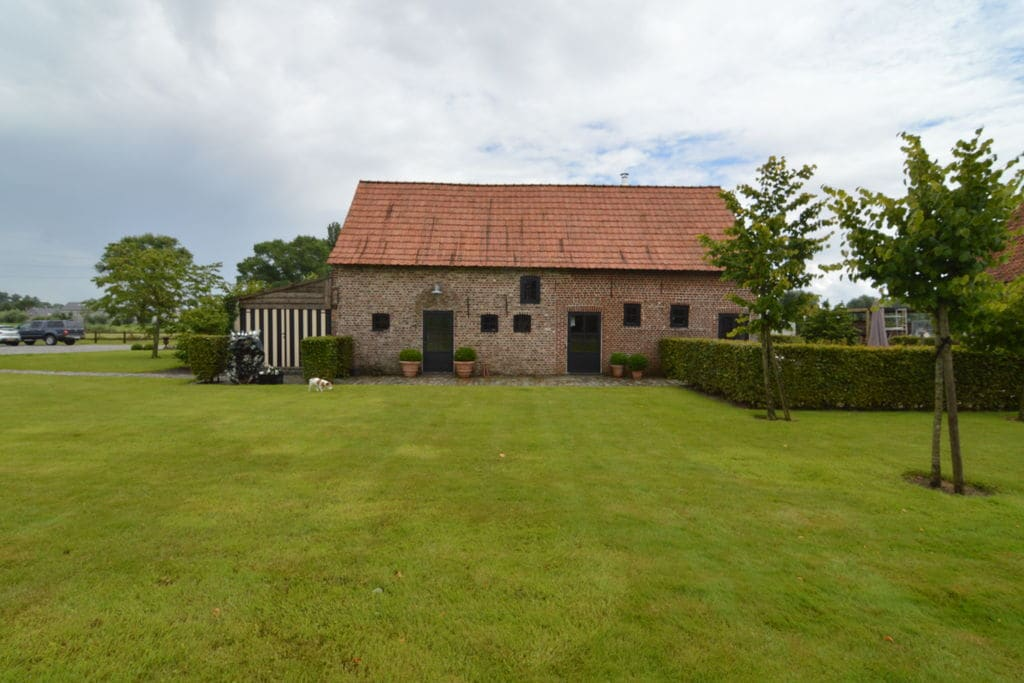 Smaakvol vakantiehuis in West-Vlaanderen met omheinde tuin en jacuzzi - Boerderijvakanties.nl