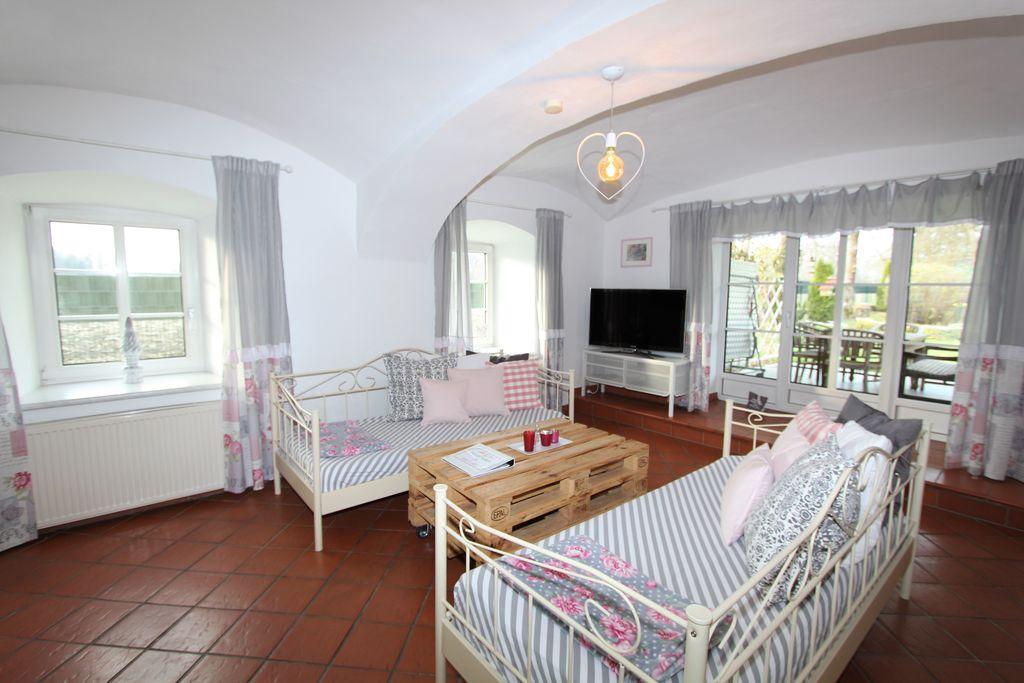 Ruim appartement bij Klagenfurt met een enorme privétuin - Boerderijvakanties.nl