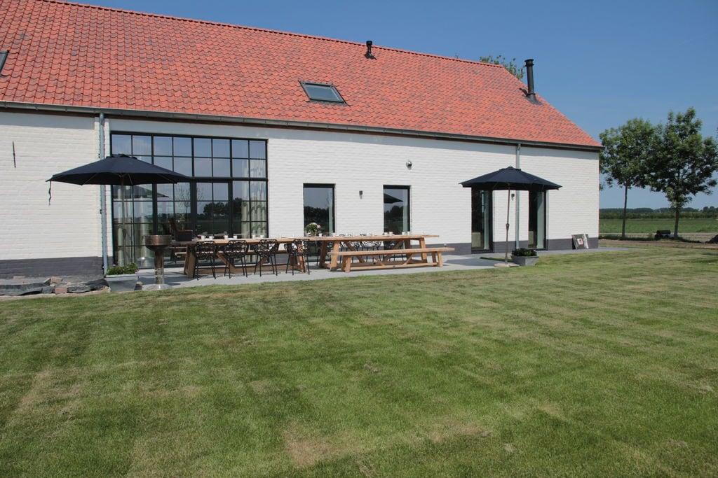Luxe villa in Zuidzande nabij het strand - Boerderijvakanties.nl