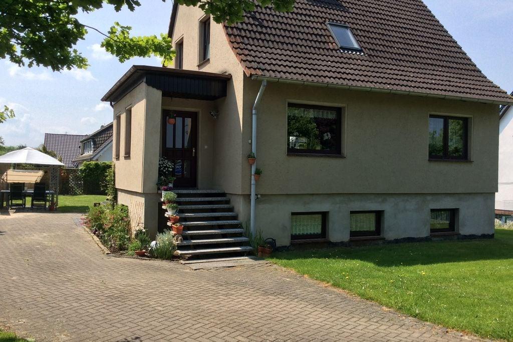 Fijn appartement in Zierow met een tuin en overdekt terras - Boerderijvakanties.nl
