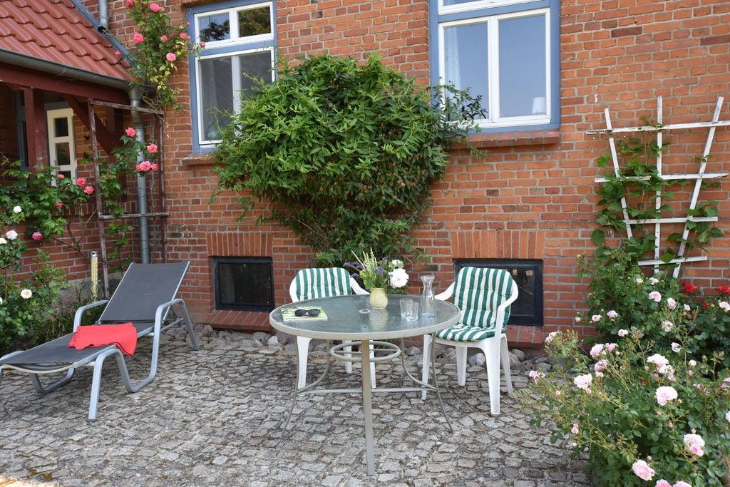 Knus appartement aan de Oostzeekust met grote tuin - Boerderijvakanties.nl