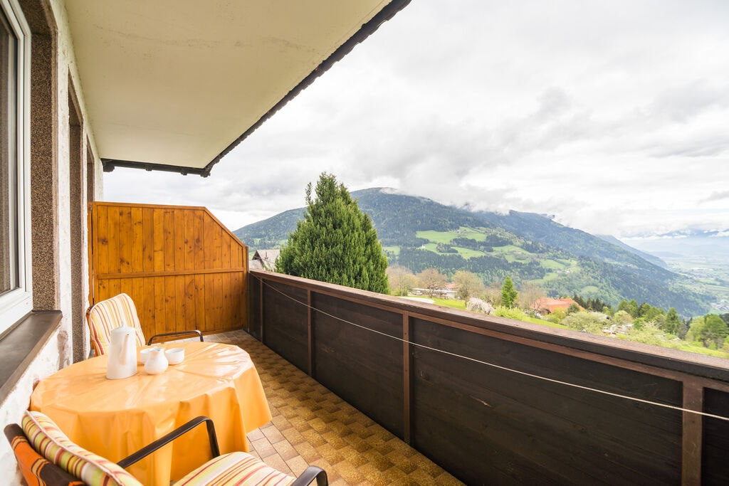Gezellig appartement in Gerlitzen met uizicht op de bergen - Boerderijvakanties.nl