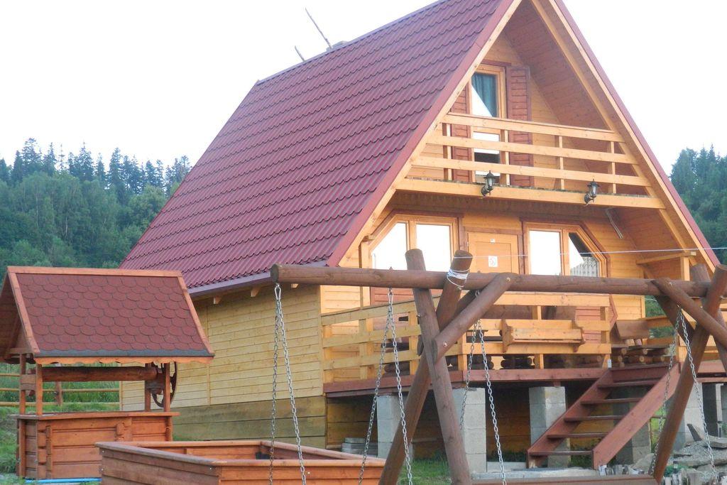 Gezellige houten cottage in Korbielów met privétuin - Boerderijvakanties.nl