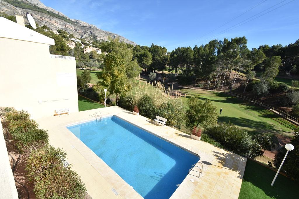 Vakantiewoning huren in Costa Blanca - met zwembad nabij Strand met wifi met zwembad voor 4 personen  Een appartement met de 9-holes Alt..