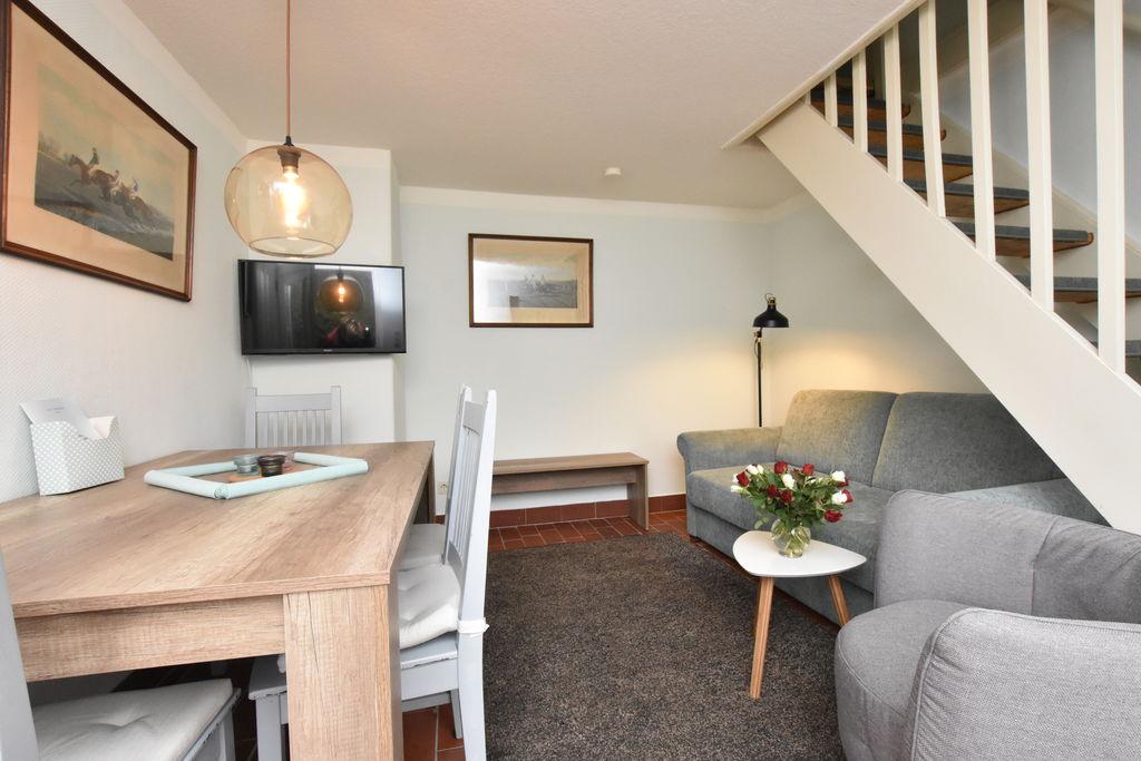 Modern appartement in Manhagen bij de zee, met sauna - Boerderijvakanties.nl