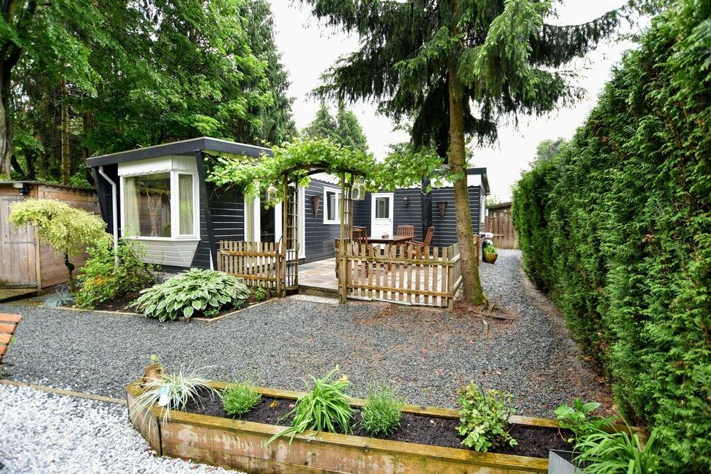 Verzorgd chalet met prachtige privé tuin met twee terrassen - Boerderijvakanties.nl