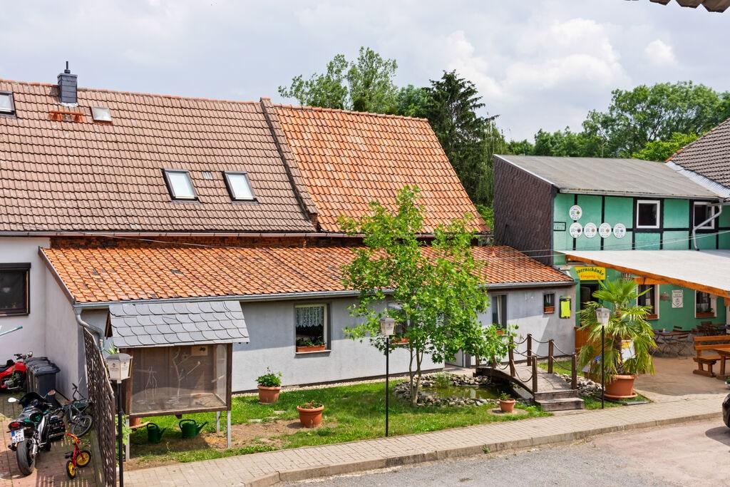 Licht en smaakvol appartement met gebruik van tuin in Meisdorf in de Harz - Boerderijvakanties.nl