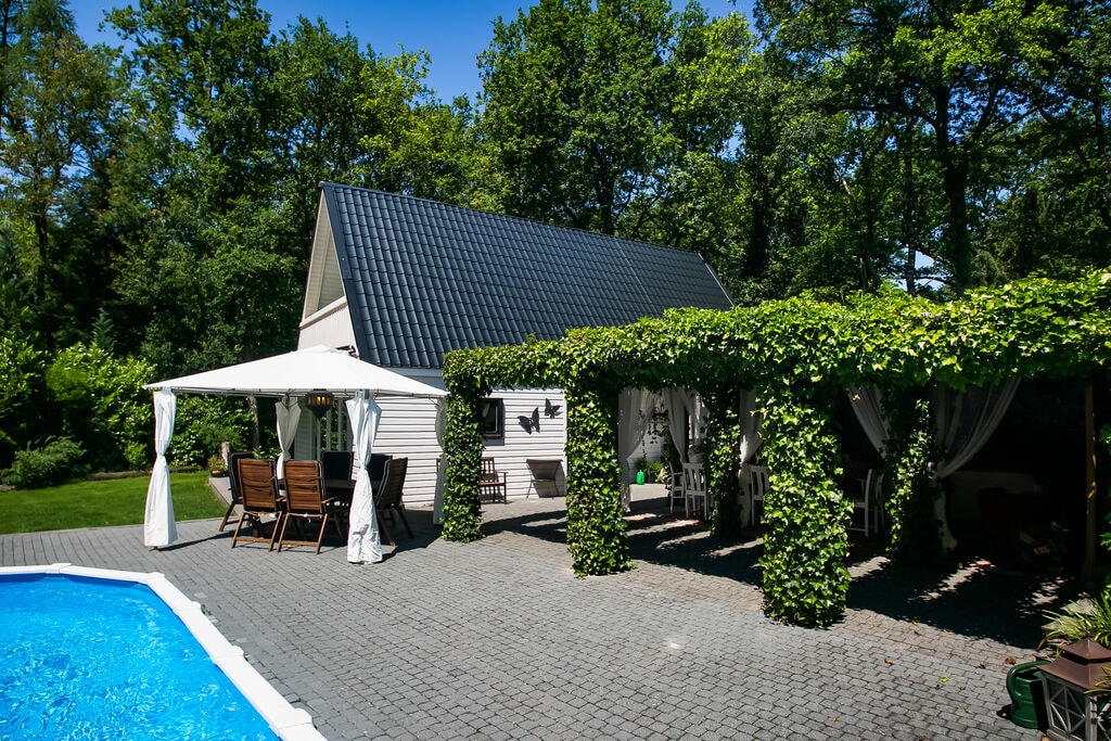 Villa met verwarmd privézwembad & overdekt terras in Ibiza-Style met buitenhaard - Boerderijvakanties.nl