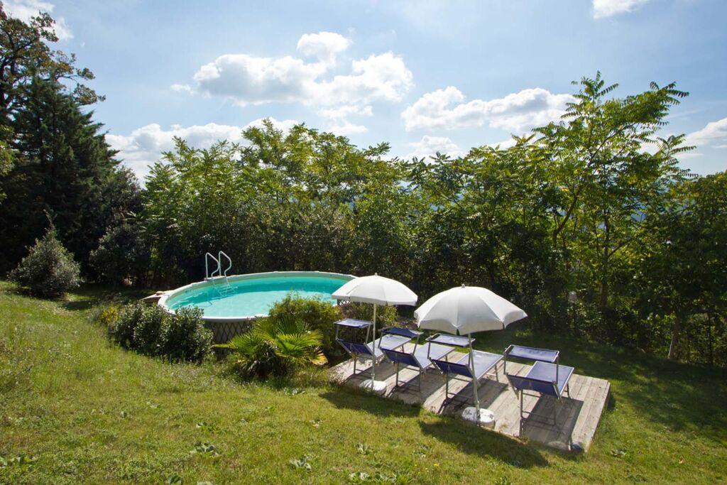 Rustiek appartement met zwembad nabij Acqualagna - Boerderijvakanties.nl