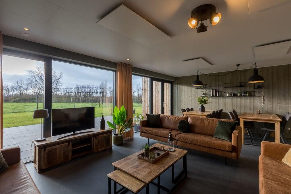 Geschakelde woning voor 8 personen in Vrouwenpolder op 800 meter van het strand - Boerderijvakanties.nl