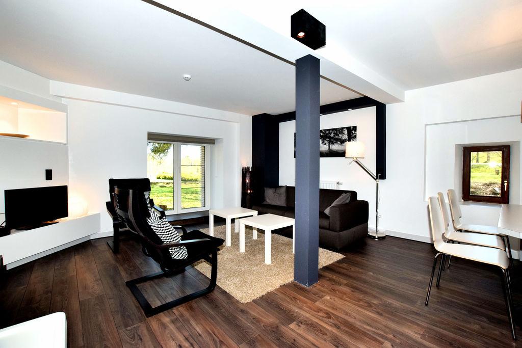 Modern appartement in Robertville met een gedeelde tuin - Boerderijvakanties.nl