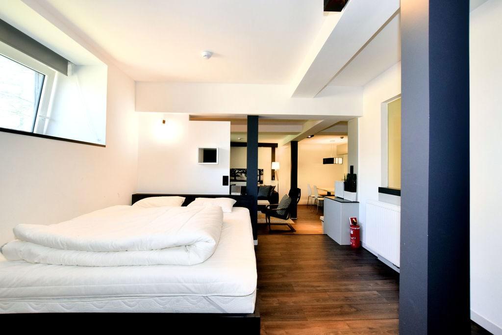Modern en comfortabel ingericht appartement in een voormalig postkoetshuis - Boerderijvakanties.nl