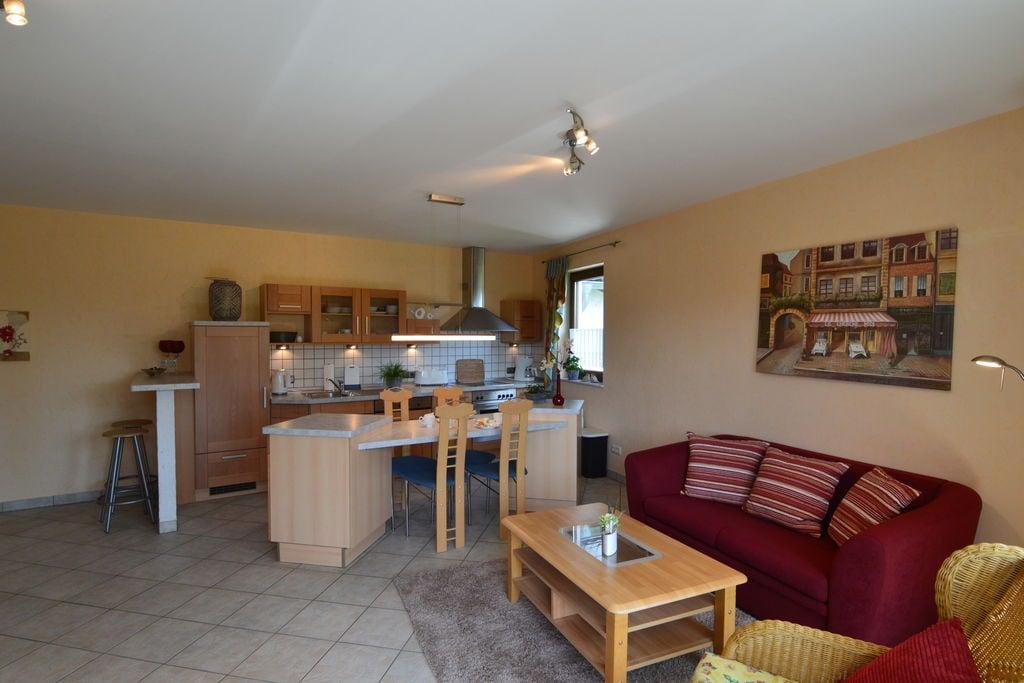 Knus appartement in Nohn met een tuin en speeltoestellen - Boerderijvakanties.nl