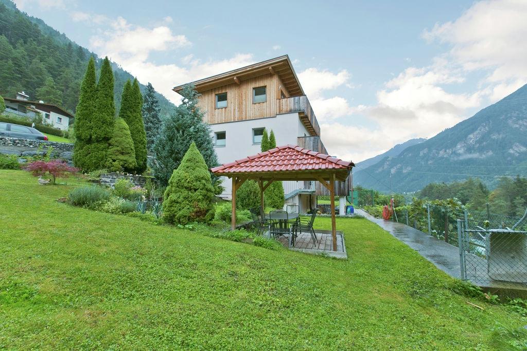 Appartement in Tirol met uitzicht op de bergen in skigebied - Boerderijvakanties.nl