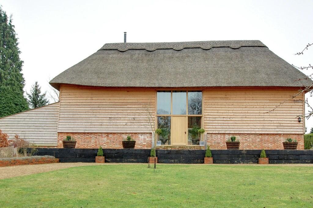 Mooi houten vakantiehuis in vroegere schuur met vide in Northiam - Boerderijvakanties.nl