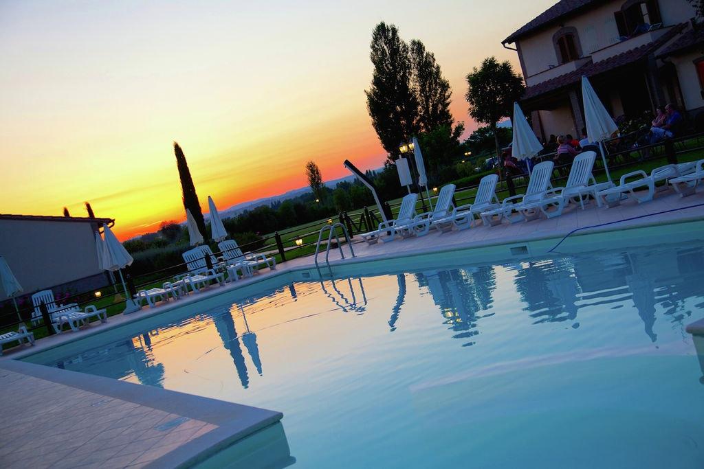 Agriturismo met uitzicht op Assisi met zwembad - Boerderijvakanties.nl