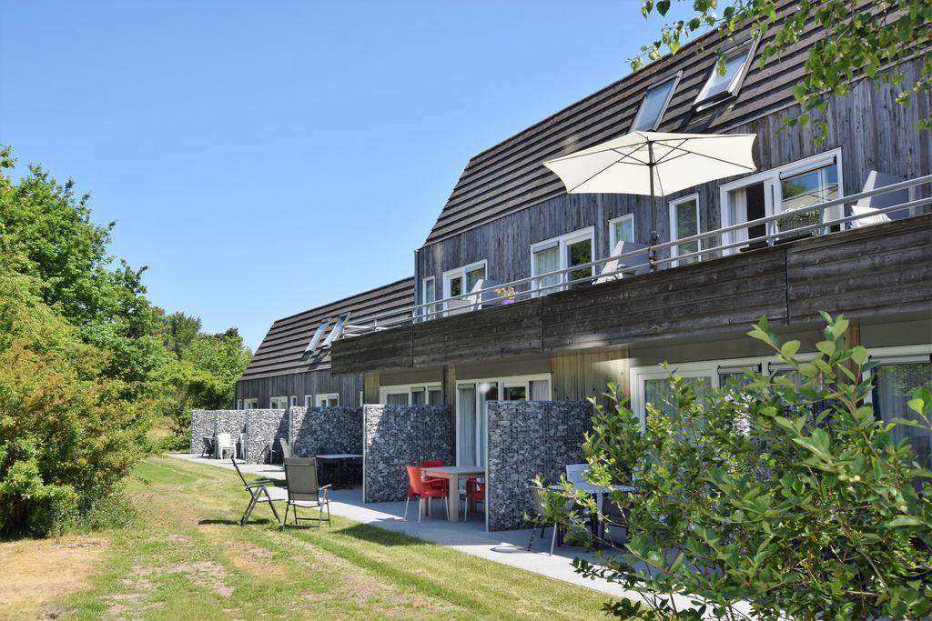 Modern appartement vlak bij zee in Hollum - Boerderijvakanties.nl