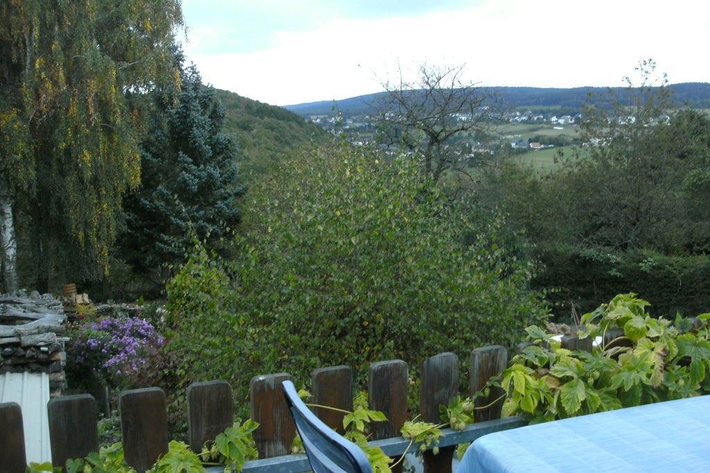 Knus appartement in Morbach met een terras en een tuin - Boerderijvakanties.nl
