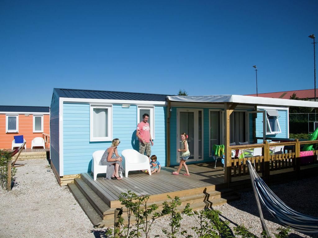 Ferienhaus Farbenfrohes Chalet mit Terrasse, nahe am See und Strand (2061530), Maurik, Rivierenland, Gelderland, Niederlande, Bild 2