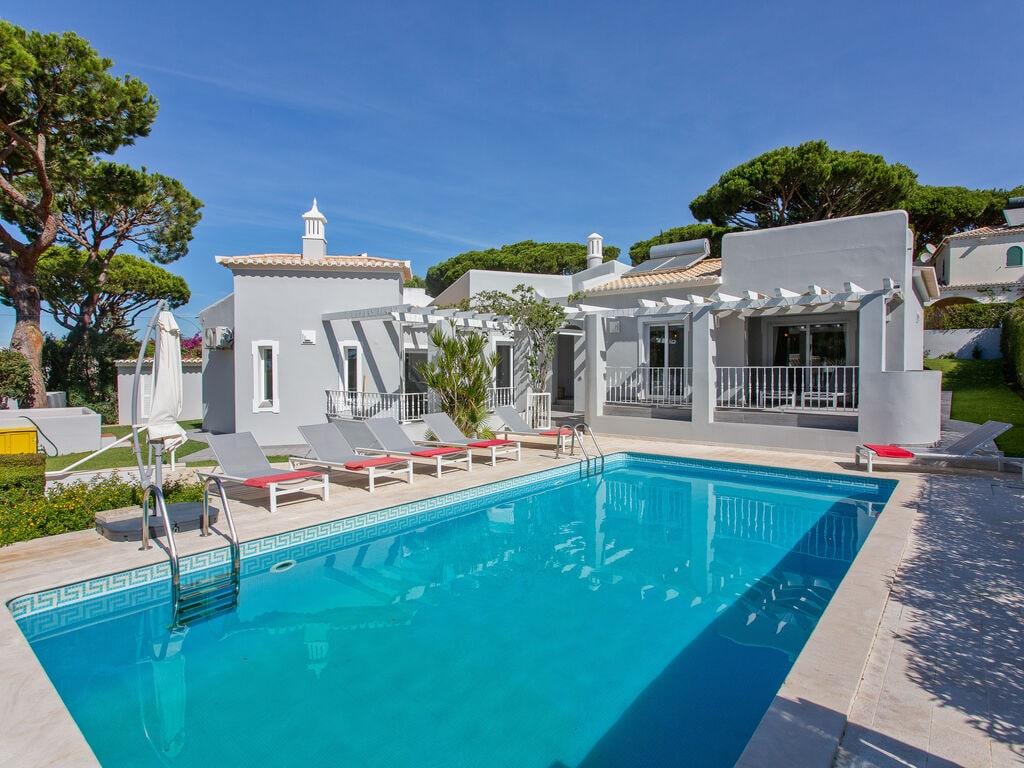 Charming Holiday Home in Quarteira with Swimming Pool