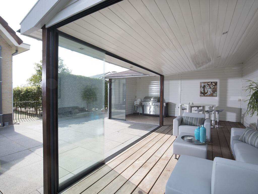 Ferienhaus Luxuriöse Villa mit Außenküche und Aussicht auf einen Freizeitsee (2752950), Maurik, Rivierenland, Gelderland, Niederlande, Bild 18