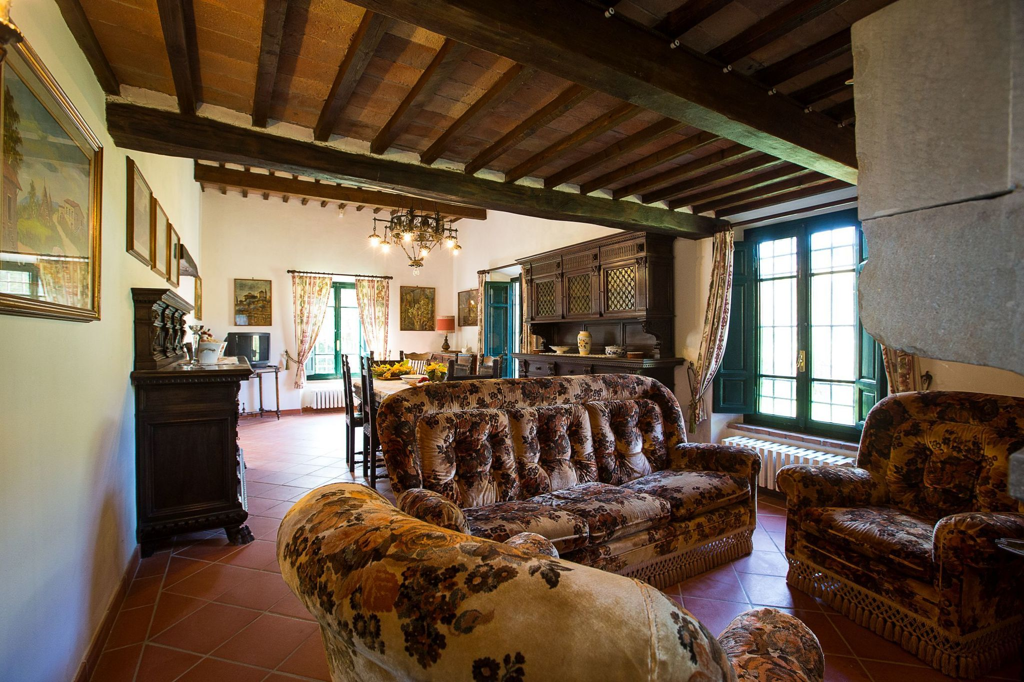 A rustic house set in the Tuscan landscape.