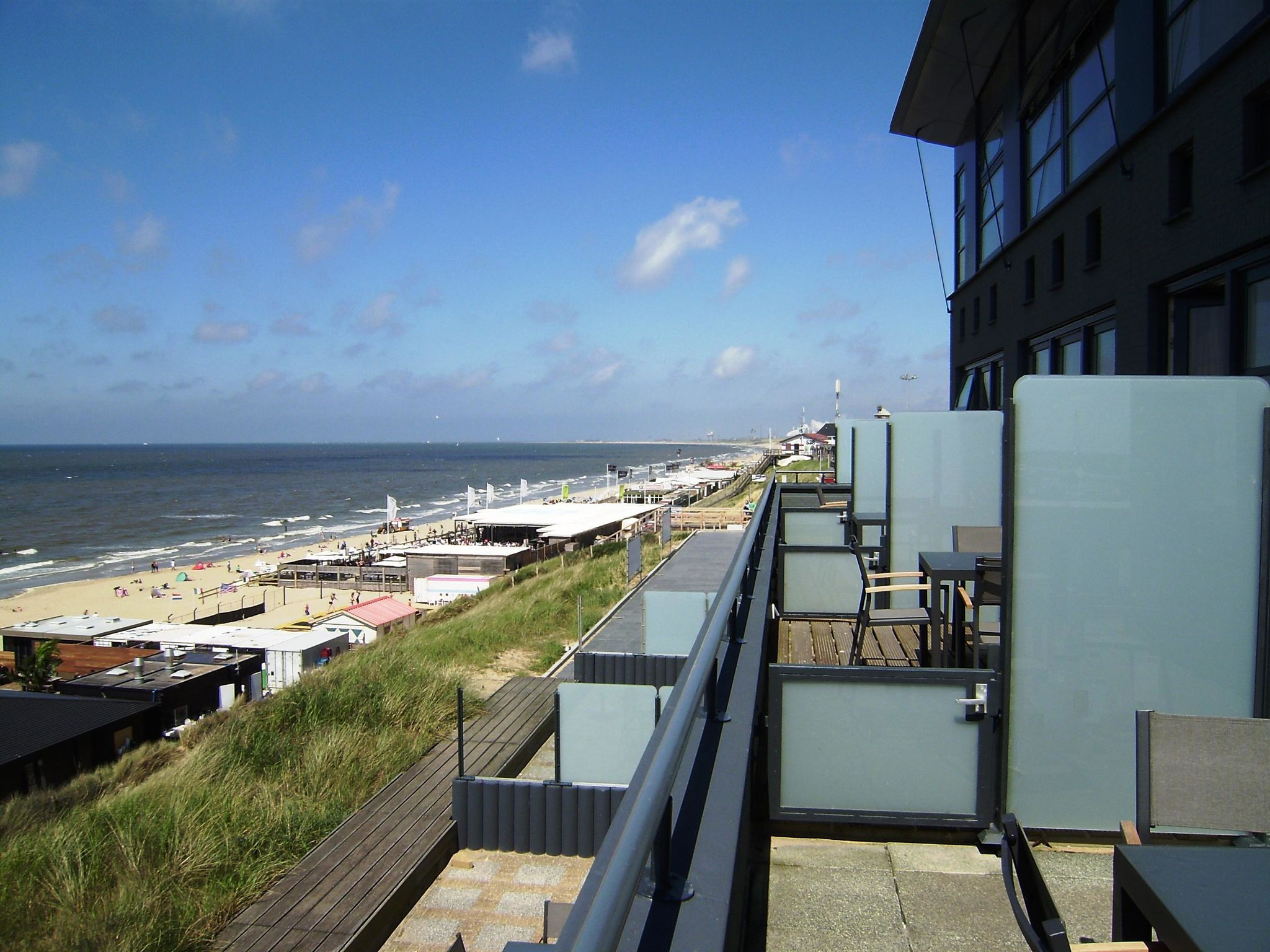 Holland | North Sea Coast North | Holiday home Strandzicht IV | all year | TerraceBalcony