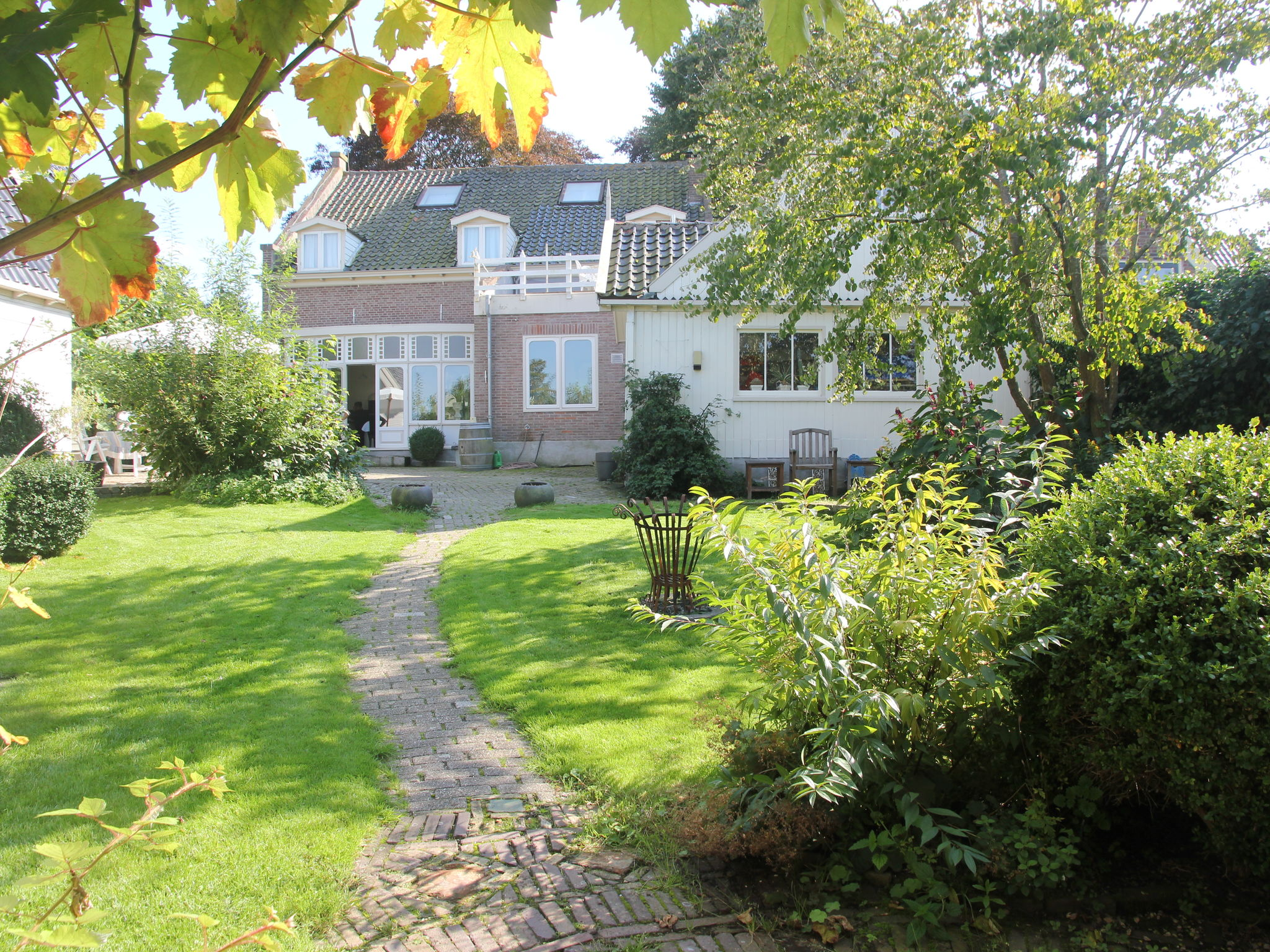 Holland | North Sea Coast North | Holiday home De Pastorie | all year | GardenSummer