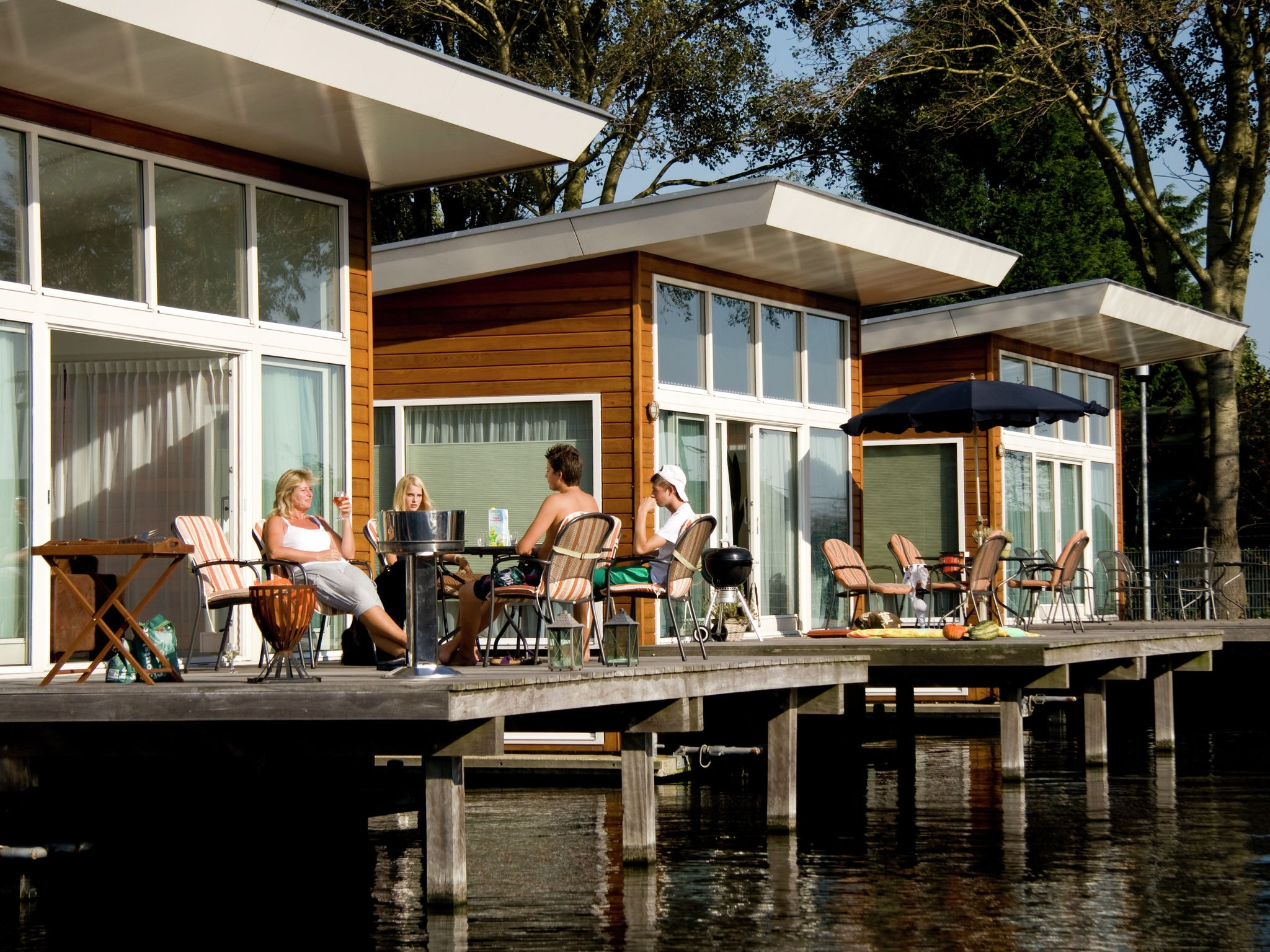 Holland | North Sea Coast North | Holiday home Waterpark de Meerparel - Lake Boathouse | all year | ExteriorSummer