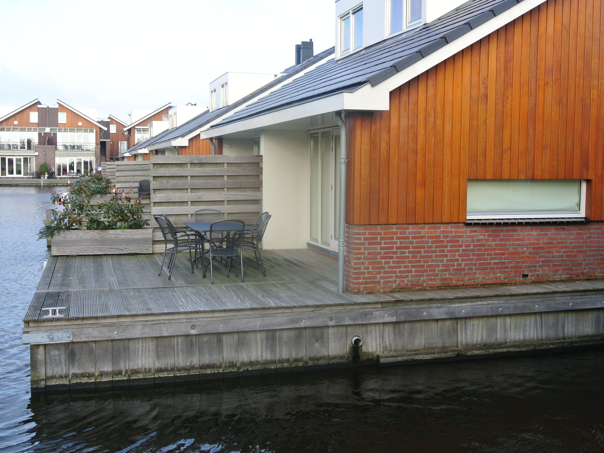 Holland | North Sea Coast North | Holiday home Waterpark de Meerparel - Lake Terrace | all year | ExteriorSummer