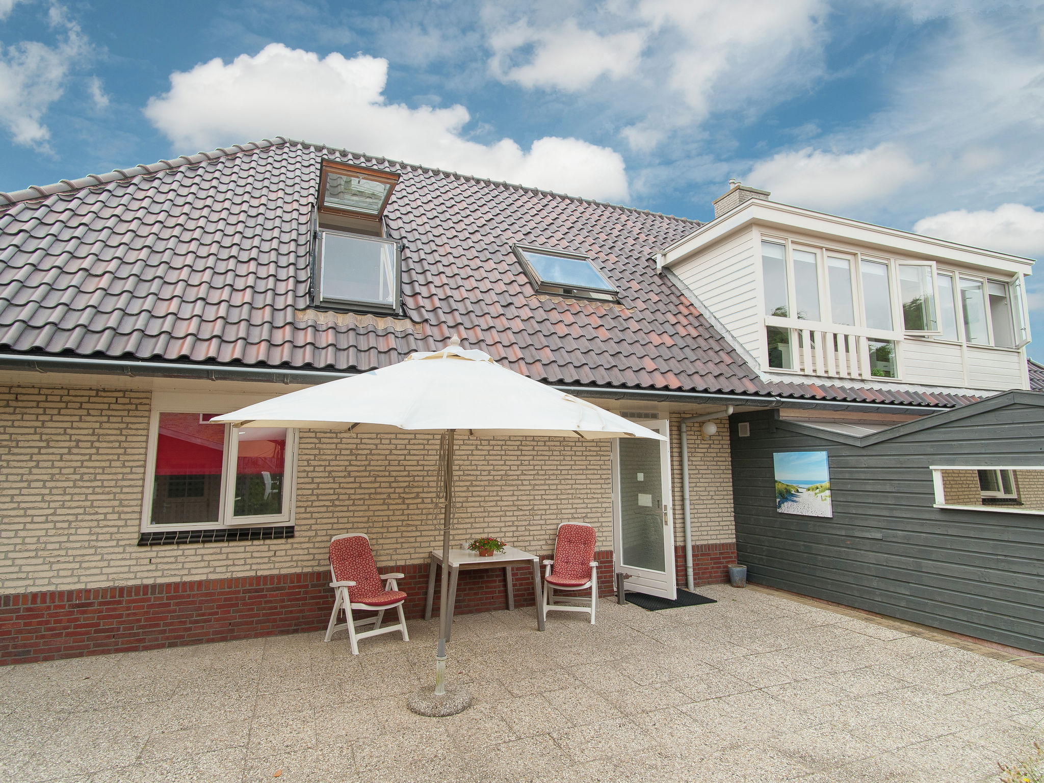 Holland | North Sea Coast North | Holiday home Zonnewijzer C | all year | ExteriorSummer