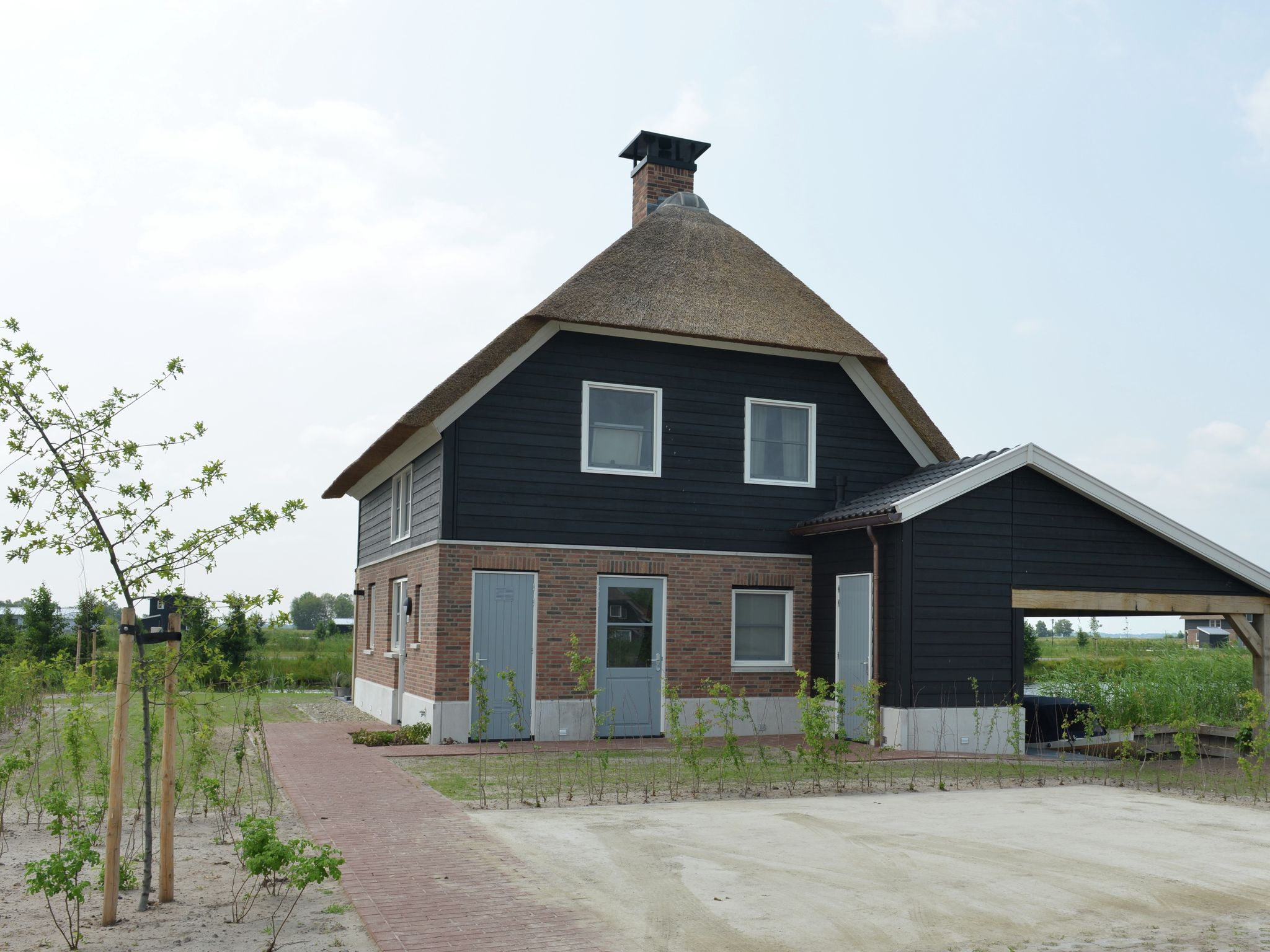 Holland | Overijssel | Holiday home Waterresort Bodelaeke - 't Rieten Schiphuis | all year | GardenSummer