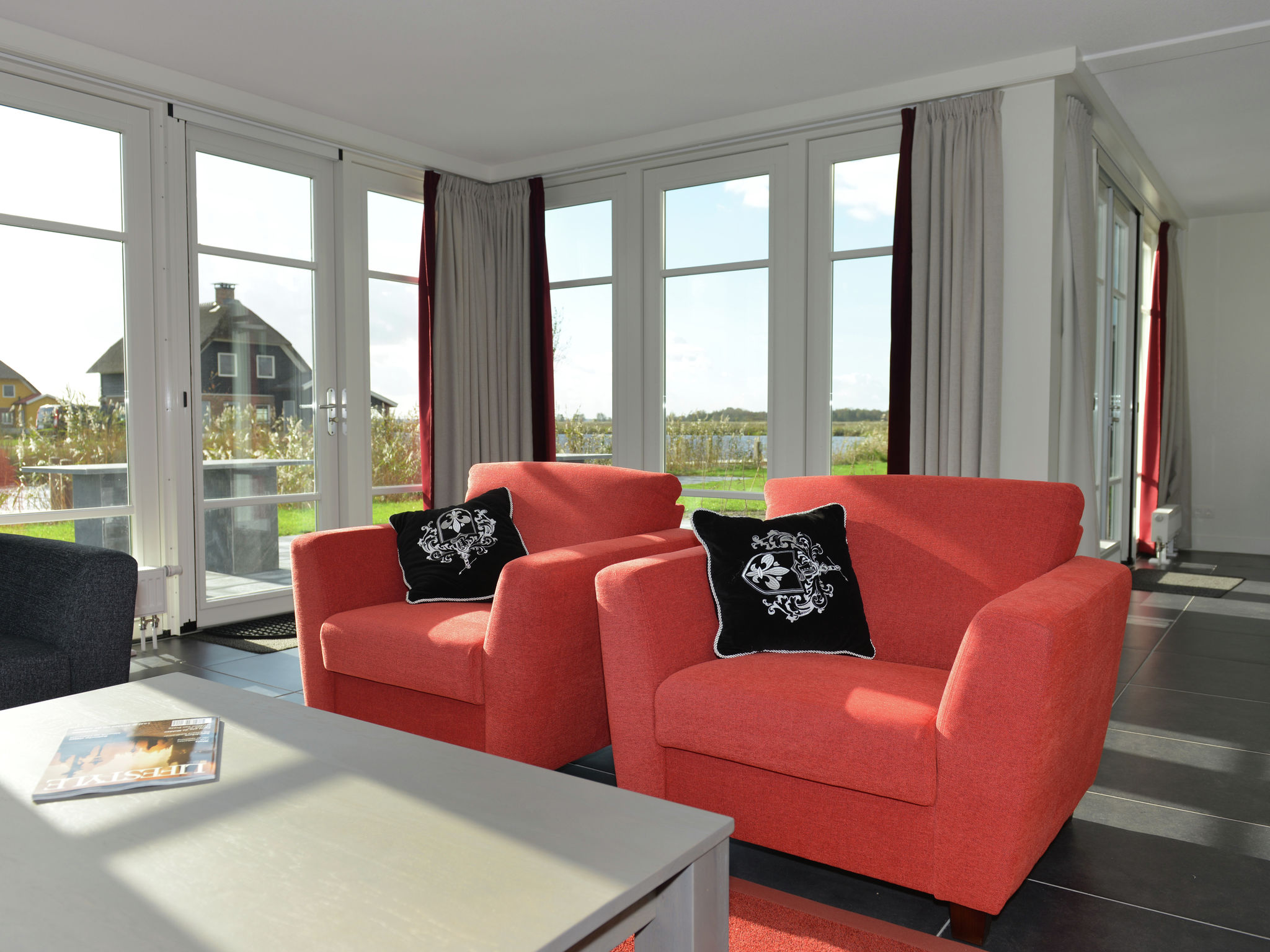 Holland | Overijssel | Holiday home Waterresort Bodelaeke - Ruimte aan 't Water Wellne | all year | LivingRoom