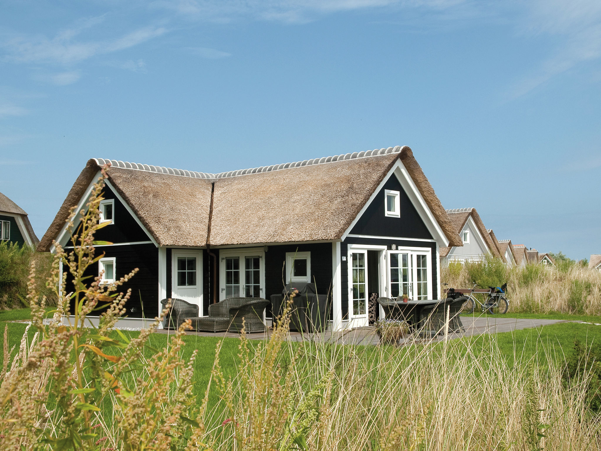 Holland | Wad Islands | Holiday home Boomhiemke - Strandjutter 4-pers | all year | ExteriorSummer