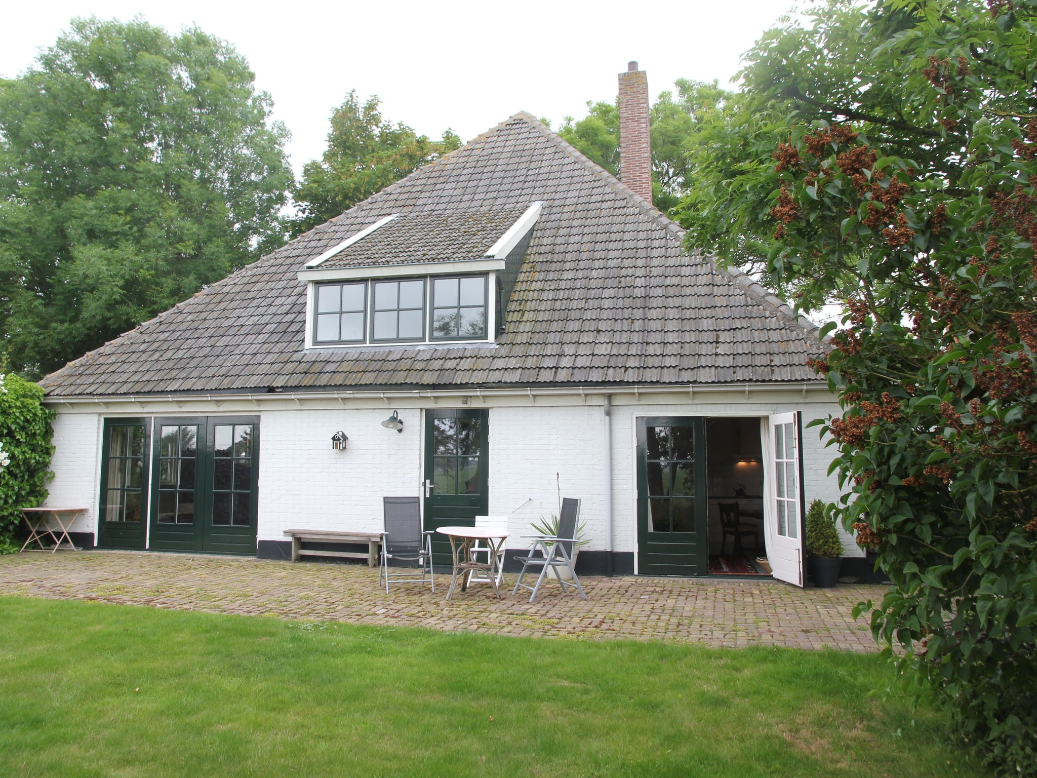 Holland | North Sea Coast North | Holiday home Aan de Westfriesedijk | all year | ExteriorSummer