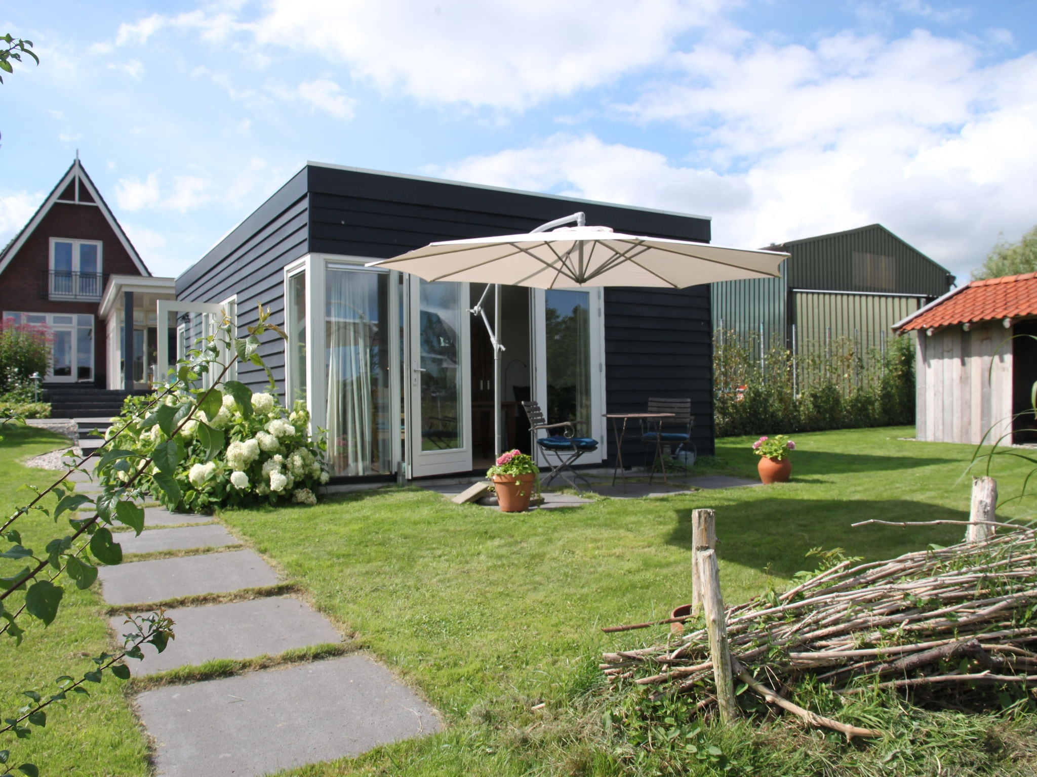 Holland | North Sea Coast North | Holiday home Charming Noord | all year | ExteriorSummer