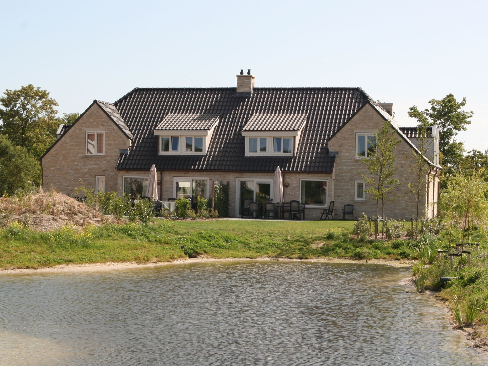 Holland | Wad Islands | Holiday home De Krim Texel - Schapen in de Wei 20 pers | all year | ExteriorSummer