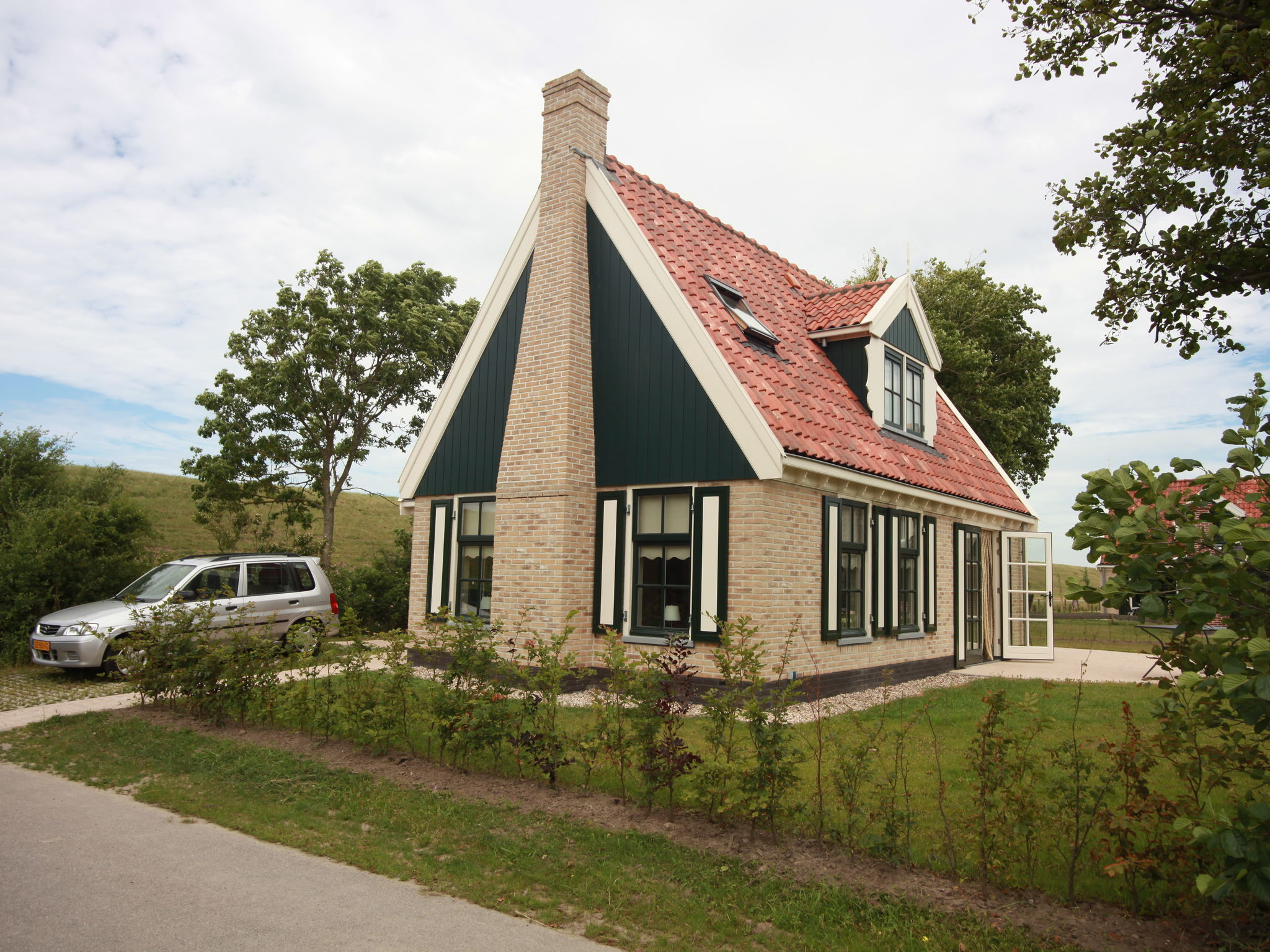 Holland | North Sea Coast North | Holiday home Recreatiepark Wiringherlant - Anno Nu 3 | all year | ExteriorSummer