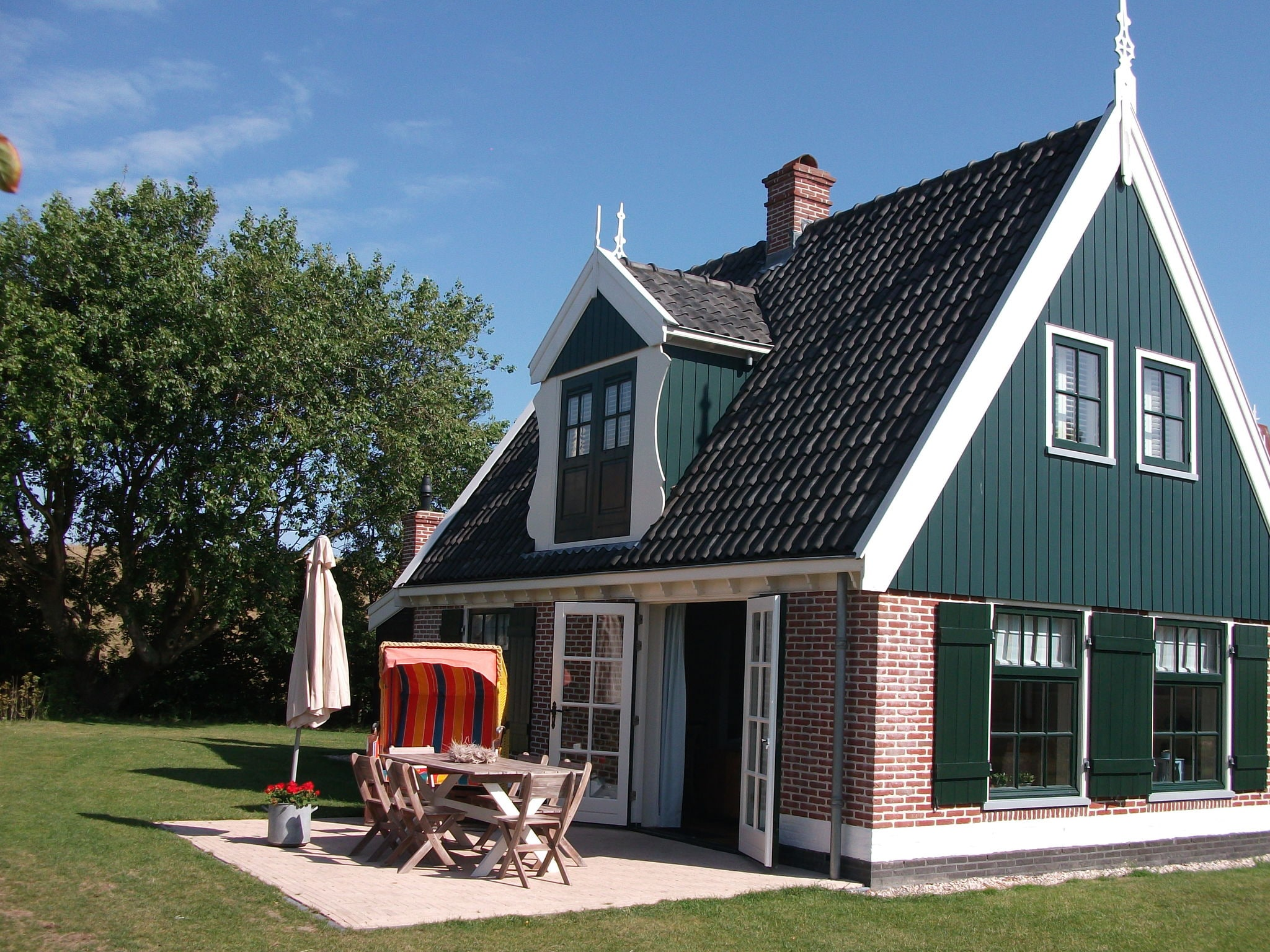 Holland | North Sea Coast North | Holiday home Recreatiepark Wiringherlant - Anno Nu 4 | all year | ExteriorSummer