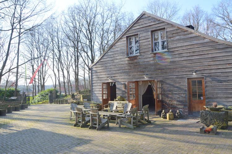 Vakantiewoning  met wifi  Wellerlooi  Robuuste lodge, puur natuur midden in het bos