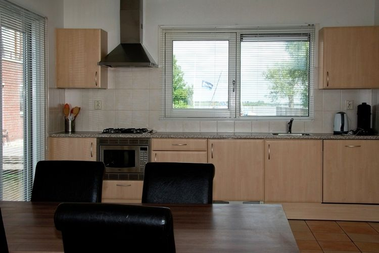 Holland | North Sea Coast North | Holiday home Waterpark de Meerparel - Lake Boathouse | all year | Kitchen