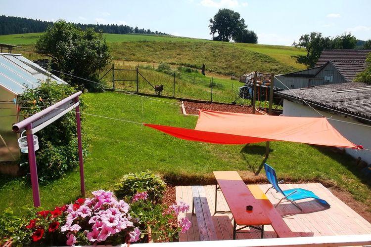 Vakantie op de boerderij - Heldere woning met balkon, tuin en kinderboerderij