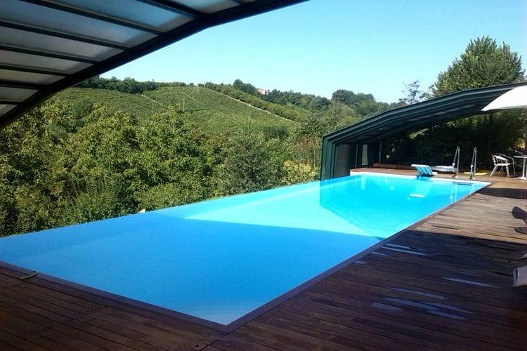 Vakantiewoning met zwembad met wifi  Asti  Deel van een oude gerenoveerde charmante huis, op het platteland met verwarmd zwembad