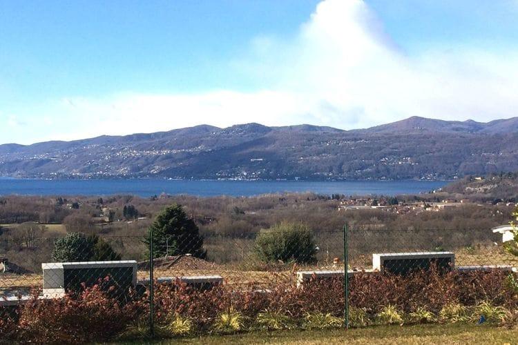 Nieuwbouw appartement, overdekt terras, tuin en prachtig uitzicht op het meer